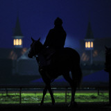 Excercise Rider Makes His Way to the Track for an Early Morning Workout at Churchill Downs Photographic Print