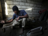 Belizer Brinel Prepares a Mold of a Pot at a Makeshift Aluminum Foundry in Port-Au-Prince Photographic Print