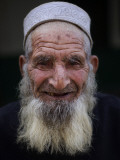 Mosque's Imam Looks on in a Poor Neighborhood of Rawalpindi, Pakistan Photographic Print
