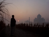 Farmer Looks at the Sunrise from His Field, with the Taj Mahal in Agra in the Background, India Photographic Print