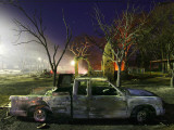 Truck Remnants in Front of a House Still Smoldering from a Grass Fire in a Small Town in Texas Photographic Print