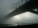 Sydney Harbor Bridge is Covered by a Thick Vail of Fog in the Early Hours of the Morning Photographic Print