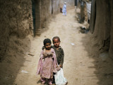 In an Alley While Waiting for the Rest of their Friends in a Poor Neighborhood in Pakistan Photographic Print
