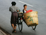 Young Myanmar Boy Looks on as He is Pushed Up a Hill Thursday in Downtown Yangon, Myanmar Photographic Print