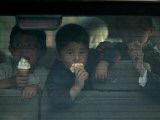 Afghan Boys Eat Ice Cream as They Sit Inside a Van in Kabul, Afghanistan Photographic Print