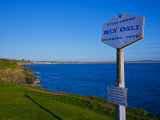 Anachronistic Sign, Guillamene Swimming Cove, Tramore, County Waterford, Ireland Photographic Print
