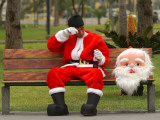 Ronald Guzman, Who Works as Santa Claus, Takes a Break in a Public Park in Lima, Peru Photographic Print