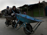 Children Push a Wheelbarrow as They Return Home in the Outskirts of Kabul, Afghanistan Photographic Print