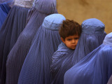 Afghan Women Wearing Burqas Line Up to Vote at a Polling Station in Kabul Photographic Print