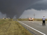 Driver Slows as a Tornado Crosses the Highway in Beaver County, Oklahoma Photographic Print