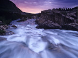 Sunrise over Swiftcurrent Falls in Glacier National Park, Montana, USA Photographic Print by Chuck Haney
