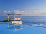 Gazebo Reflecting on Pool with Sea in Background, Long Island, Bahamas Photographic PrintKent Foster
