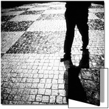 Silhouette of Mans Legs Walking on Cobblestone Street at Night Prints by Elke Hesser