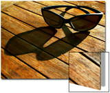 Sunglasses and their Shadow on a Wooden Table Print by Claire Morgan