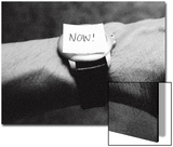 The Word Now as a Reminder Attached to a Watch on a Male Arm Prints by Winfred Evers