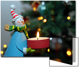 Close-Up of a Snow Man Candle in Front of a Tree with Christmas Lights Posters by Winfred Evers