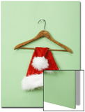 Santa Hat on Wooden Hanger Prints by Laura Johansen