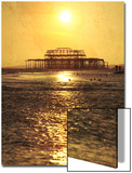 Sun over Ruin of West Pier, Brighton, Sussex, England Prints by Neil Overy