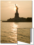 Sun Setting Behind the Statue of Liberty on a Summer Evening Posters by John Nordell
