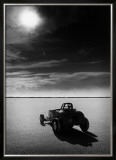 Salt Flat Roadster and Sun Framed Giclee Print by David Perry