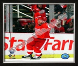 Daniel Cleary celebrates after scoring a shorthanded third period goal against the Pittsburgh Pengu Framed Photographic Print