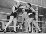 Two Women Box in a Ring, with a Referee Present Photographic Print