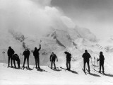 A Group of Skiers, Standing on Top of a Slope, Prepare to Ski Downhill Photographic Print