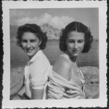 Two Women Friends Sitting Back to Back on a Beach in Italy Photographic Print by Vanessa Wagstaff