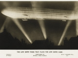 Zeppelin Illuminated by Searchlights Photographic Print