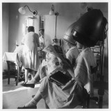 Women Sitting under Hair Dryers at the Hairdressers Photographic Print by Henry Grant