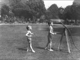 Two Boys with a Water Hose in a Devon Garden Photographic Print