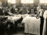 Young Girls Ironing in Laundry Room, Surrey Photographic Print by Peter Higginbotham