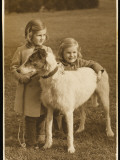 Two Little Girls, Probably Sisters, Pose with their Dog in a Field Photographic Print