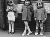 Three Young Girls on the Pavement - Manchester, 1965 Photographic Print by Shirley Baker