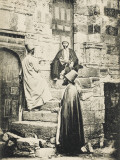 Three Mevlevi Dervishes Outside Ancient Buildings Photographic Print