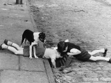 Two Young Boys Peer Down a Drain Photographic Print by Shirley Baker
