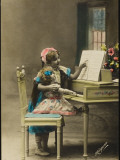A Little Girl Attempts to Give Her Doll a Piano Lesson Photographic Print