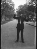 Traffic Police Officer Giving Stop Hand Signal. Metropolitan Police Photographic Print