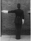 Traffic Police Officer Giving Stop Signal, Metropolitan Police Photographic Print