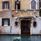 Venetian Facade with Sculpted Heads Photographic Print by Vanessa Wagstaff