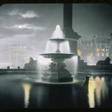 Trafalgar Square at Night Showing the Fountains Photographic Print