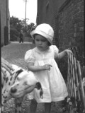 A Little Girl in a Street with a Dalmatian Dog Photographic Print by Vanessa Wagstaff