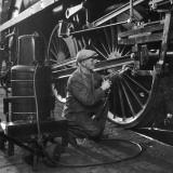 Welder Working on a Steam Engine Piston Photographic Print by Heinz Zinran