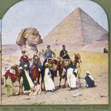 Tourists on Camels at Gizeh, the Sphinx and a Pyramid Behind Them Photographic Print