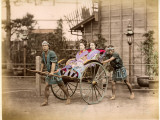 Two Well-Dressed Japanese Ladies Take a Ride in a Rickshaw Powered by Two Rickshaw Drivers Photographic Print