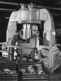 A Ryder Disc Brake Pad Machine in Action in a Car Factory. Photograph by Heinz Zinram Photographic Print by Heinz Zinran