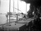 Tables at the Lido Cafe in Venice, with a Boat Out on the Water Photographic Print by Vanessa Wagstaff