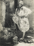 A Moorish Algerian Woman Raising Water from a Well in a Small Wooden Bucket Photographic Print