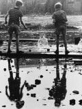 Two Boys Drop Bricks into a Puddle Photographic Print by Shirley Baker