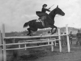 A Woman Show Jumping in 1923 Photographic Print by Vanessa Wagstaff